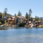 Cottage Insurance FAQs- Beautiful cottage surrounding by rocks and water.