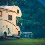 Motorhome by a lake at dusk,