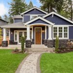 Understanding Home Insurance- Jeffery & Spence Insurance- Beautiful exterior of newly built luxury home. Yard with green grass and walkway lead to ornately designed covered porch and front entrance.